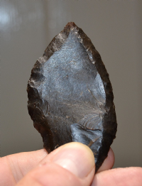 A large, well worked and superb example of a Mesolithic flint spear head, Caspian Culture, Algeria. SOLD